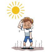 校庭で暑さにバテる男子生徒