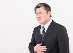 胃が痛むサラリーマン